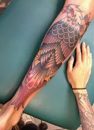 tattoo eagle girl leg tattoos tattoo insider