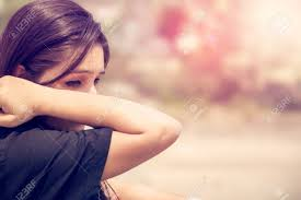 images of sad girl sad girl wiping tears outdoors stock photo picture and royalty