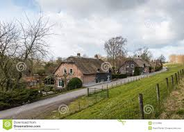 thatched farm houses along a dutch stock photo image 51374865