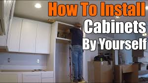 how to secure kitchen base cabinets to wall how to install base cabinets the handyman