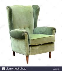 vintage upholstered green velvet armchair with a high wing back