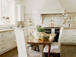 french country kitchen with white cabinets black french range cottage kitchen mary evelyn interiors