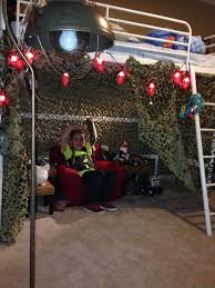 soldier room camo netting and lantern string lights from