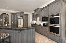 How To Faux Finish Kitchen Cabinets by From White Laminate Thermofoil Kitchen Cabinets To Gorgeous Gray