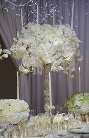 wedding reception centerpieces silver candlestick with a center arrangement to compliment