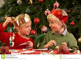 children making christmas decorations together royalty free stock