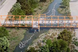 yard bridge la river a bright orange bridge over the river could begin