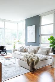 living room brown chairs white shelves gray sofa gray recliners