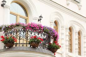 beautiful balcony beautiful balcony with flowers and windows of house stock image