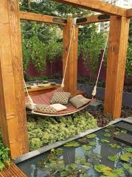 furniture pergola design with brown cozy swing bed with brown