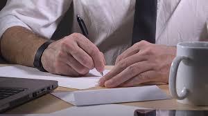 How To Write Resignation Notice Businessman Writing Resignation Notice Letter Leaving Job Work