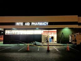 robert dyer bethesda row car crashes into rite aid at westwood