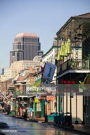 flowers and flags hang from balconies on bourbon street office