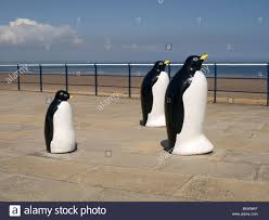 ornamental statues of penguins on seaside promenade at redcar