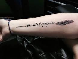 outstanding eagle feather with text tatted up