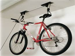 Bike Hanger Ceiling by Interior Bike Storage Hanging On White Concrete Ceiling With Wire