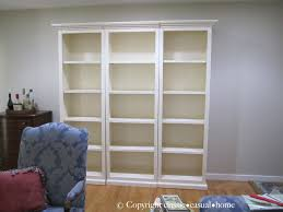 White Sling Bookcase by Blue White And A Ballard Bookcase Before And After Classic