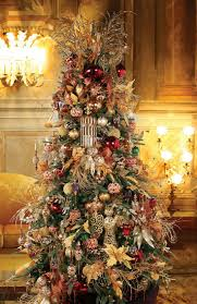 an elegant christmas tree decorated with ornate hand blown glass
