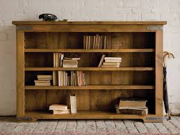 terrific unfinished oak low bookcase over stones floors and white