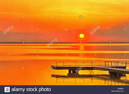 Colorful Painting by Colorful Painting Of Sunset Over Water Lake Summer Landscape Stock