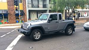 truck jeep wrangler pick up truck may not be a wrangler variant could be a standalone
