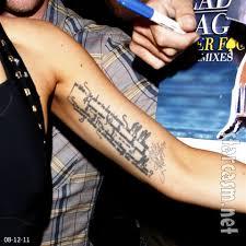 photo what does lady gaga u0027s left arm tattoo say what rilke
