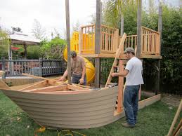 playhouse designed by wooden ship theme and brown wooden decks