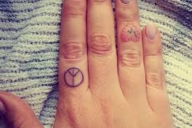 finger tattoo peace 50 of the tiniest most tasteful tattoos ever