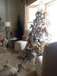 living room white flocked christmas tree trimmed chandelier