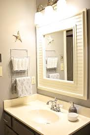 bathroom towel racks ideas towel holder idea like putting wood around the mirror