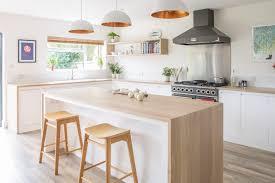 kitchen island worktops uk minimalist white kitchen with warm accents sustainable kitchens