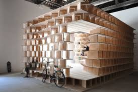 make yourself at home in this giant bookshelf mental floss