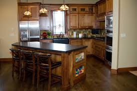kitchen mission style cabinet doors natural stone backsplash
