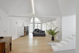 Attic Apartment by An Attic Apartment In Slovenia With A Faceted Geometric Ceiling