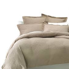bedroom comfortable duvet vs comforter with beige pillows for