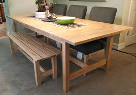 if space is tight around your dining table a bench might be a good fit