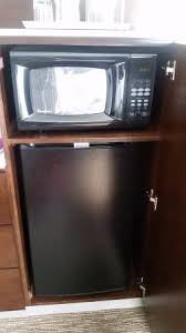 Hide Microwave In Cabinet Mini Fridge And Microwave Hidden In Cabinet Picture Of Radisson