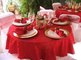 red table with drapery table clothes and golden plates with glass