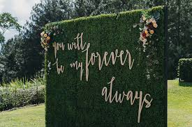 wedding backdrop greenery australian garden wedding with a patterned wedding dress ruffled