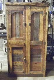 clothes storage cabinets with doors hunting cabinet by barn wood furniture it has a bar for clothes