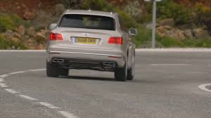 suv bentley white bentley bentayga diesel driving video in white sand trailer