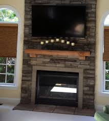 eldorado stacked stone with mortar mantle and raised fireplace