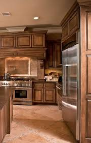how to make brown kitchen cabinets look rustic rustic brown cabinets brown kitchen cabinets tuscan