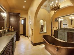 beautiful bathroom with victorian mirror with gold frame featuring
