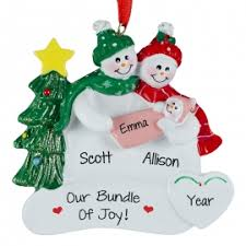 snow new parents holding baby ornament personalized