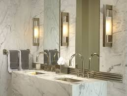 bathroom with wall sconces and marble tiles choosing the best