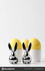 easter egg stands yellow painted easter eggs egg stands statuettes rabbits white