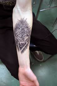 Forearm Wolf - grey wolf and lettering tattoos on forearm photos pictures