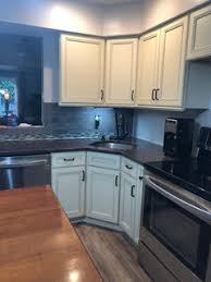 why do my white cabinets look yellow help my new antique white kitchen cabinets look yellow