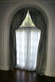 how hang curtains and window arched window treatments glamorous curtains for high windows